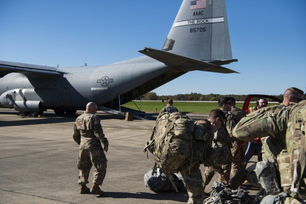 Members of Headquarters Company, 89th Military Police Brigade, Task Force Griffin get ready to board a C-130J Super Hercules from Little Rock, Arkansas, at Fort Knox, Kentucky, in support of Operation Faithful Patriot in a photo dated Monday.