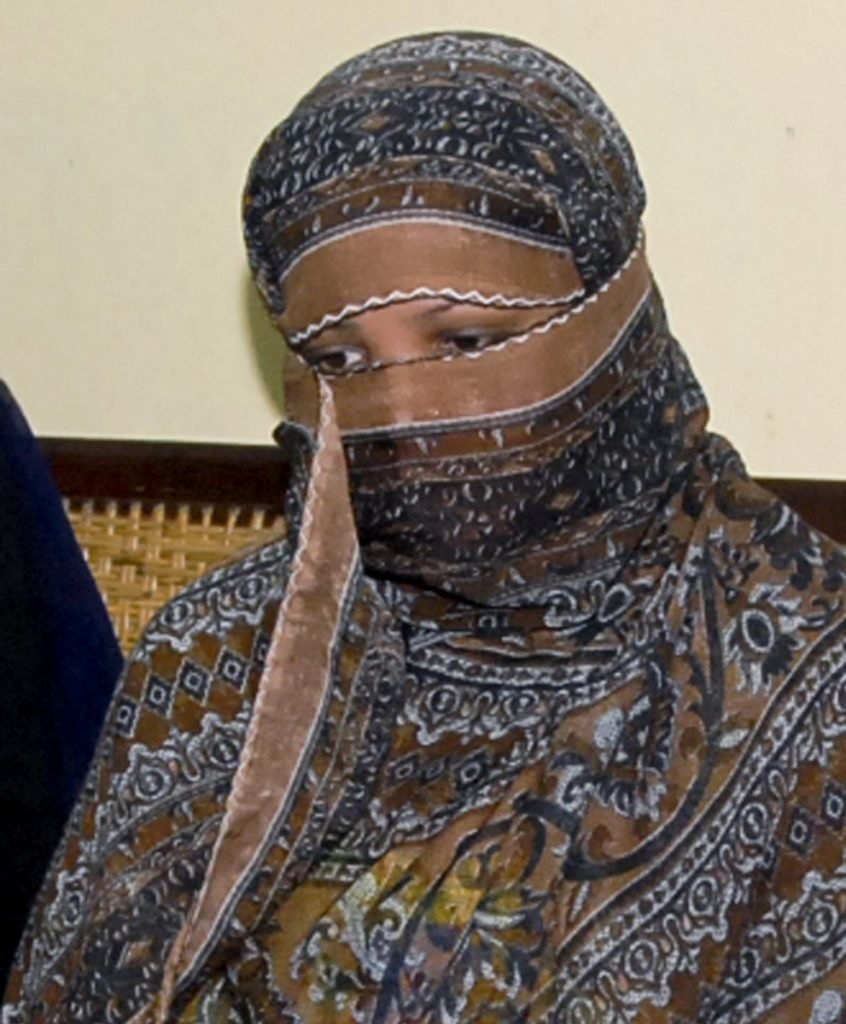 Asia Bibi, a Pakistani Christian woman, listens to officials at a prison in Sheikhupura near Lahore, Pakistan, in 2010.