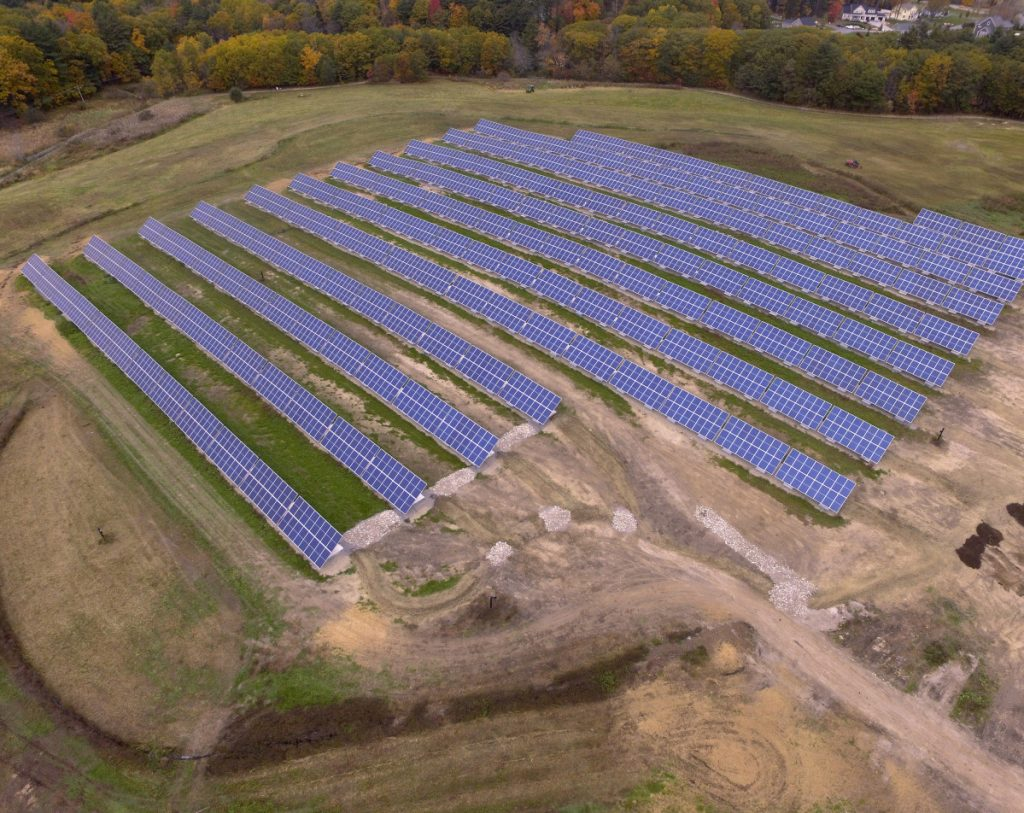 Portland's solar power array is nearing completion after delays to fix the landfill beneath it.