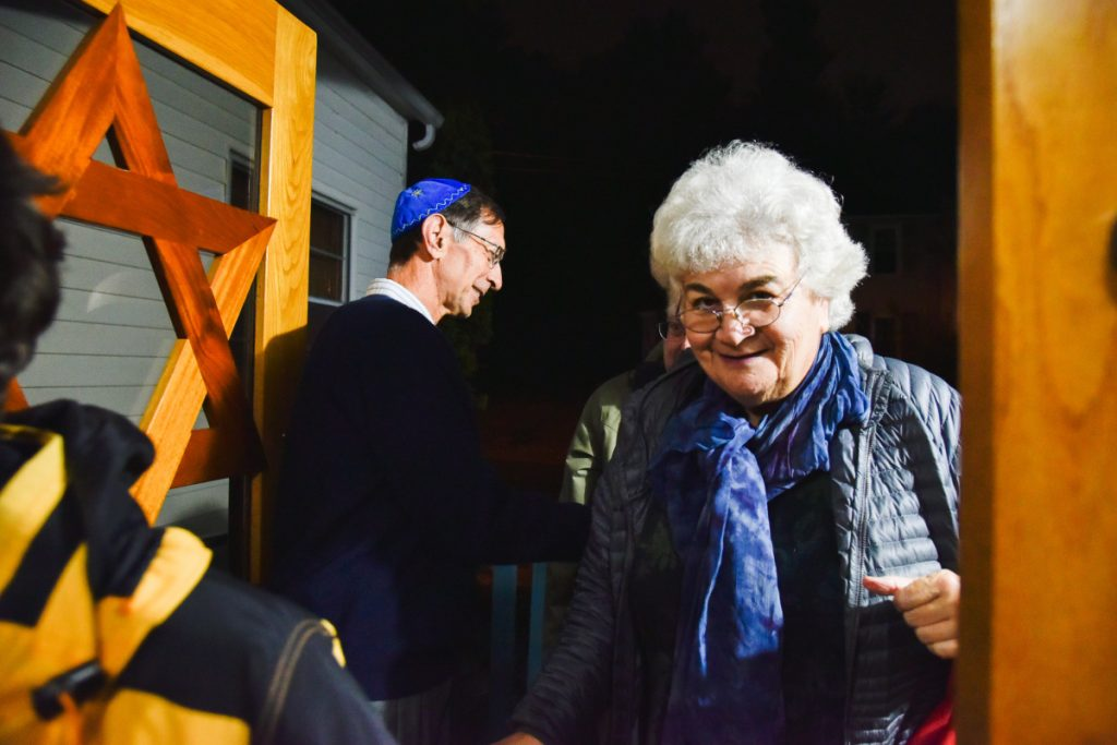 Former Rabbi Susan Bulba Carvutto enters Temple Beth El in Augusta for a Shabbat service on Friday evening, as Michael Dickey greets guests and congregants.