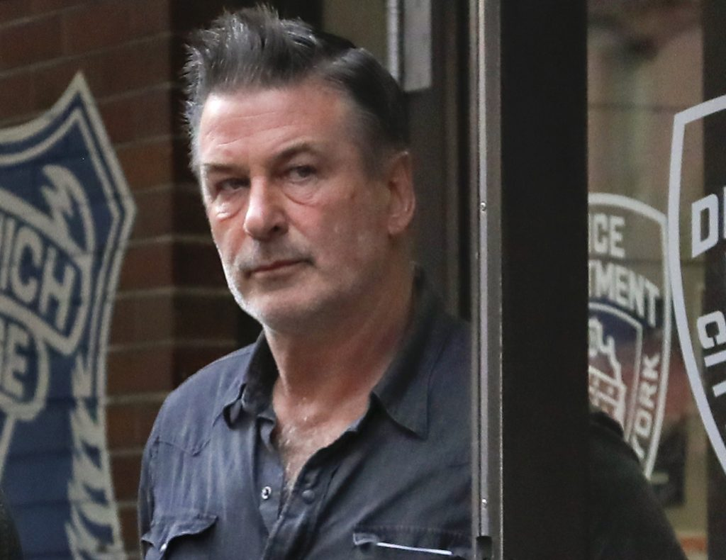 Actor Alec Baldwin leaves the New York Police Department's 10th Precinct on Friday.