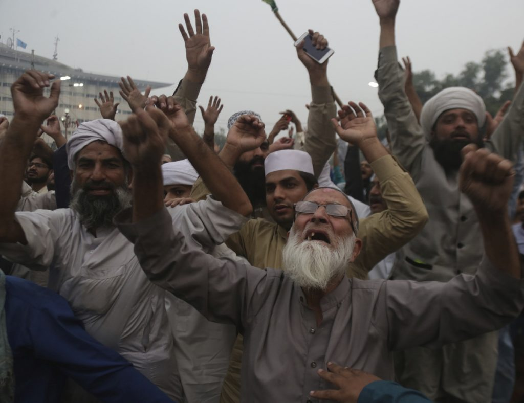 Protesters rally against the Pakistan Supreme Court decision that acquitted Asia Bibi, a Christian woman, who spent eight years on death row accused of blasphemy, in Lahore, Pakistan, on Friday. Bibi's lawyer, Saiful Malook, has left the country after receiving death threats.