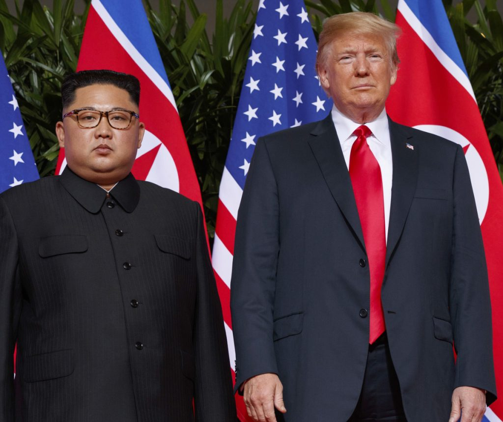 President Trump stands with North Korean leader Kim Jong Un on Sentosa Island in Singapore on June 12.