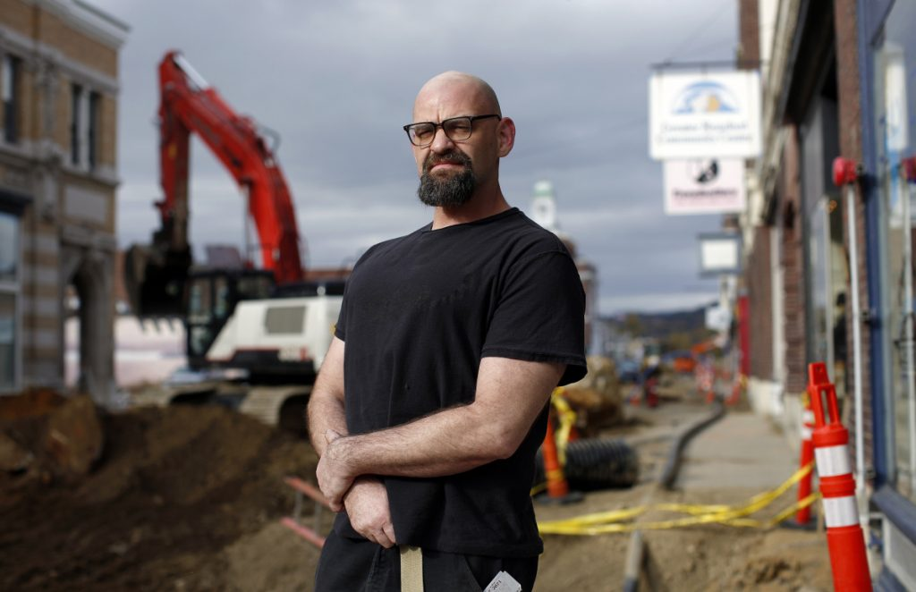 """Dawson Walton, a personal trainer at the Greater Rumford Community Center: """"I feel like I'd rather be apolitical at the moment. ... The machine is going to do what it's going to do."""""""