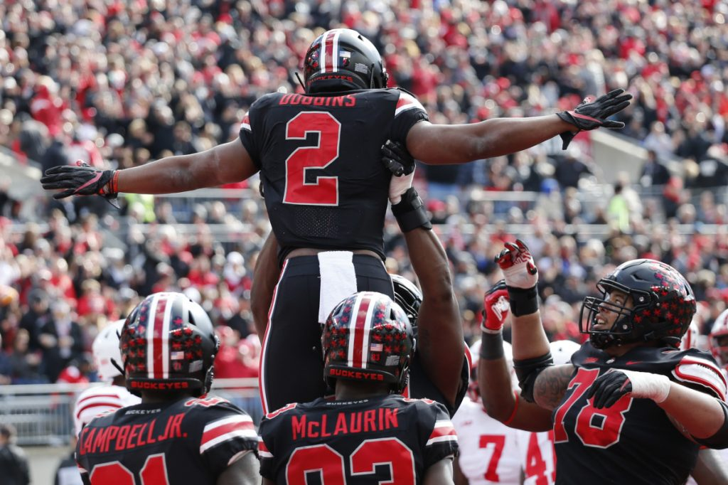 J.K. Dobbins of eighth-ranked Ohio State celebrates with teammates Saturday after scoring a touchdown in the first half of the 36-31 victory against Nebraska at Columbus, Ohio. Dobbins finished with a season-high 163 yards rushing.