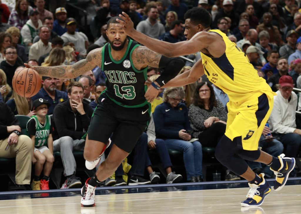Celtics forward Marcus Morris drives against Indiana's Thaddeus Young during the Pacers' 102-101 Saturday night in Indianapolis. (Associated Press/R Brent Smith)
