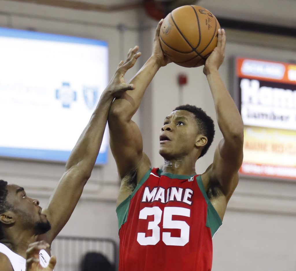 P.J. Dozier, who scored 26 points Sunday for the Maine Red Claws, lifts a shot over Shake Milton of the Delaware Blue Coats during a 132-124 victory.