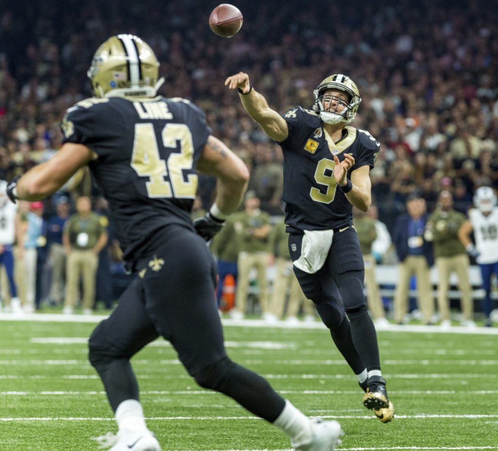 Drew Brees of the New Orleans Saints tosses a pass to Zach Line during the Saints' 45-35 victory Sunday against the previously undefeated Los Angeles Rams.