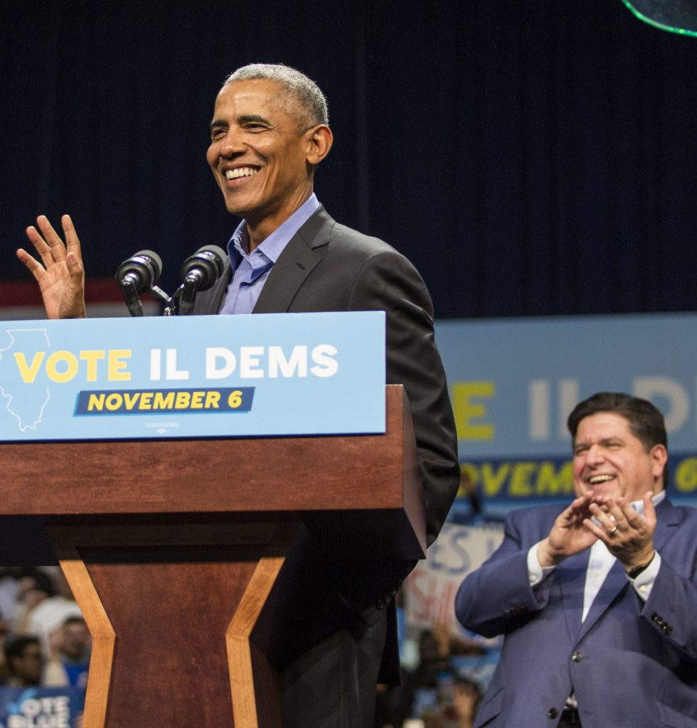 Former President Barack Obama campaigns for Illinois gubernatorial candidate J.B. Pritzker, right, in Chicago Sunday.