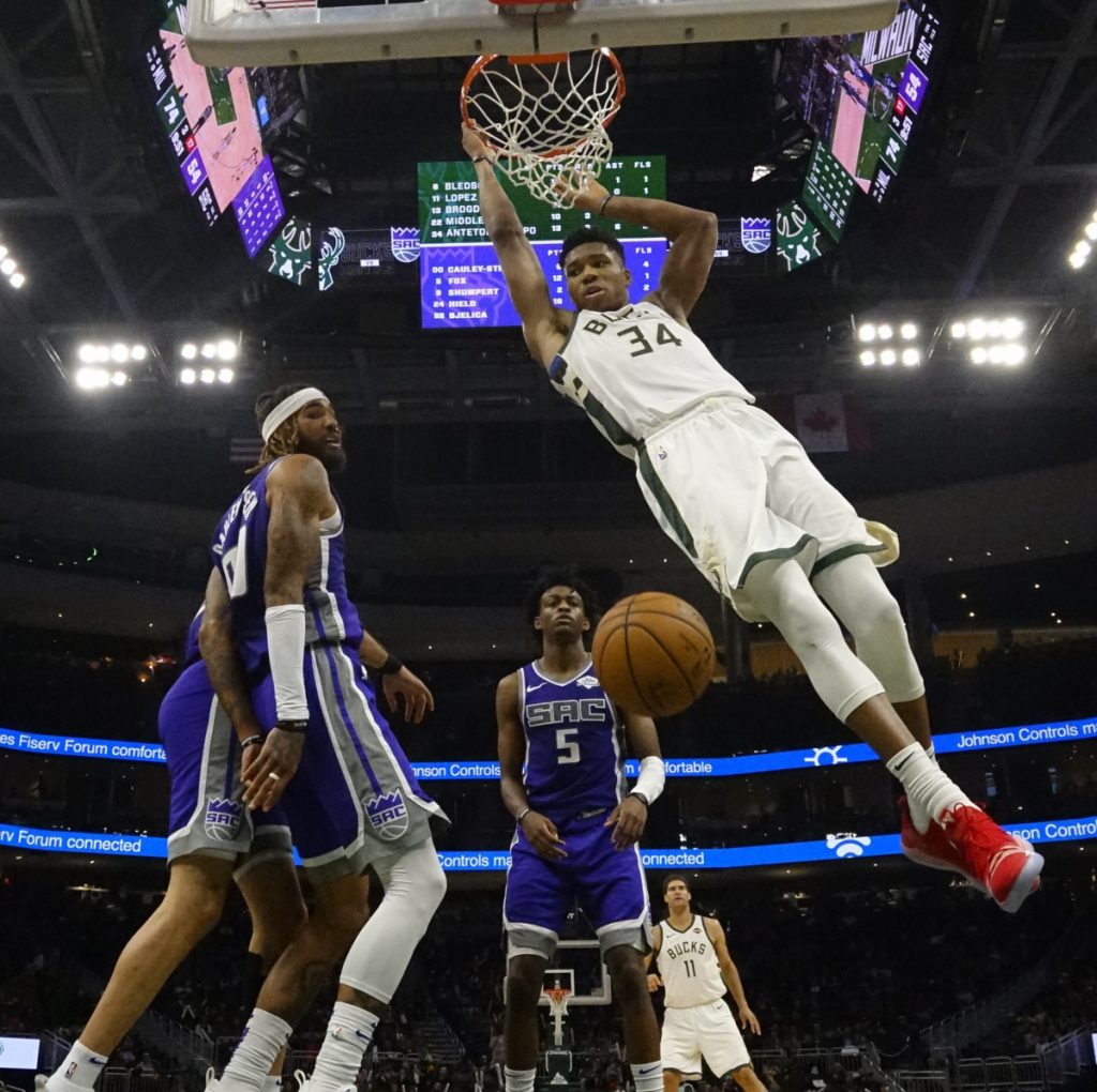 Giannis Antetokounmpo of the Bucks dunks during the second half Milwaukee's 144-109 home rout of the Kings on Sunday. The Bucks improved to 8-1.