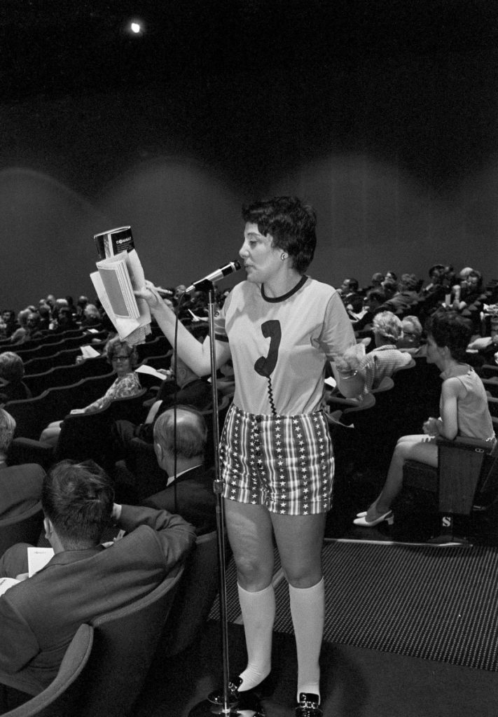 Evelyn Y. Davis wears hotpants as she speaks in May 1971 at the annual stockholders meeting of the Communications Satellite Corp. in Washington. Davis, who owned stock in more than 80 public companies and liked to make a show of her presence at shareholder meetings, died Sunday at age 89.