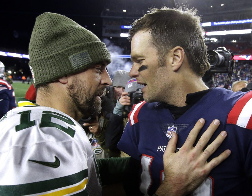 Aaron Rodgers of the Green Bay Packers, left, and Tom Brady of the New England Patriots are two great quarterbacks in totally different situations.