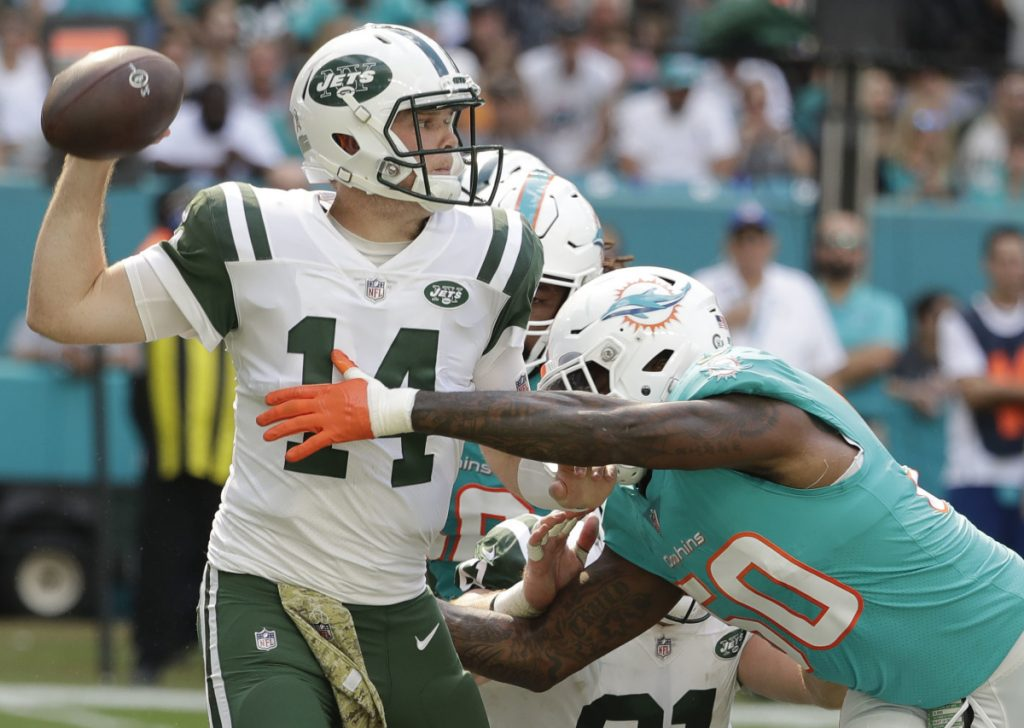 New York Jets quarterback Sam Darnold, pressured Sunday by Andre Branch of Miami, is putting the burden on himself for a three-game losing streak.