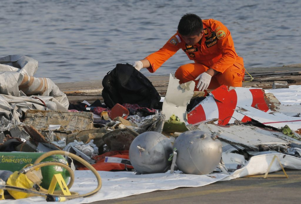 A member of Indonesian Search and Rescue Agency inspects debris believed to be from a Lion Air passenger jet that crashed into the sea off Java Island at Tanjung Priok Port in Jakarta, Indonesia, on Oct. 29.