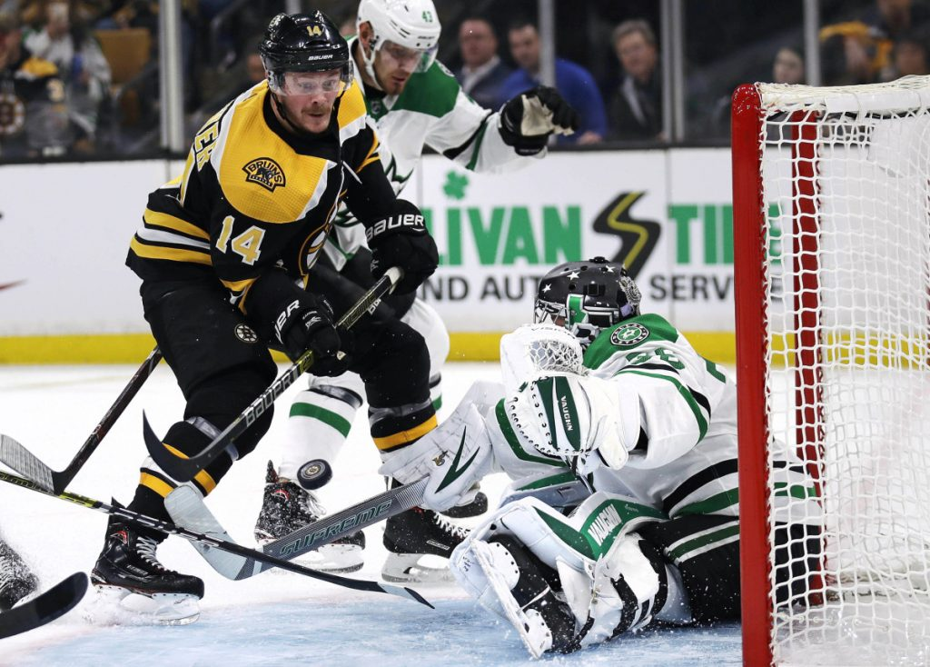 Dallas Stars goaltender Anton Khudobin, right, makes a save on a shot by Boston Bruins right wing Chris Wagner, left, during the second period of their game Monday in Boston.