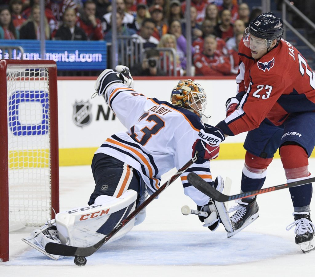 Dmitrij Jaskin of the Washington Capitals tries to get the puck past Edmonton Oilers goaltender Cam Talbot during the first period of Washington's 4-2 victory at home Monday night.