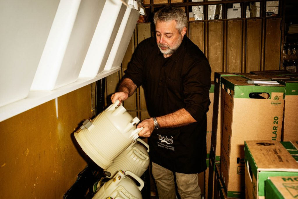Jimmy Streit handles a plastic keg in the cellar of his bar in Copenhagen. Carlsberg has rolled out the technology more aggressively than other brewers.