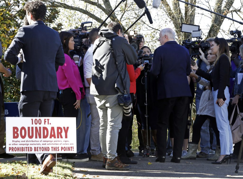 Former Gov. Phil Bredesen is interviewed past the 100-foot polling place boundary after voting Tuesday in Nashville Tenn. Bredesen is running against Rep. Marsha Blackburn R-Tenn. for the U.S. Senate