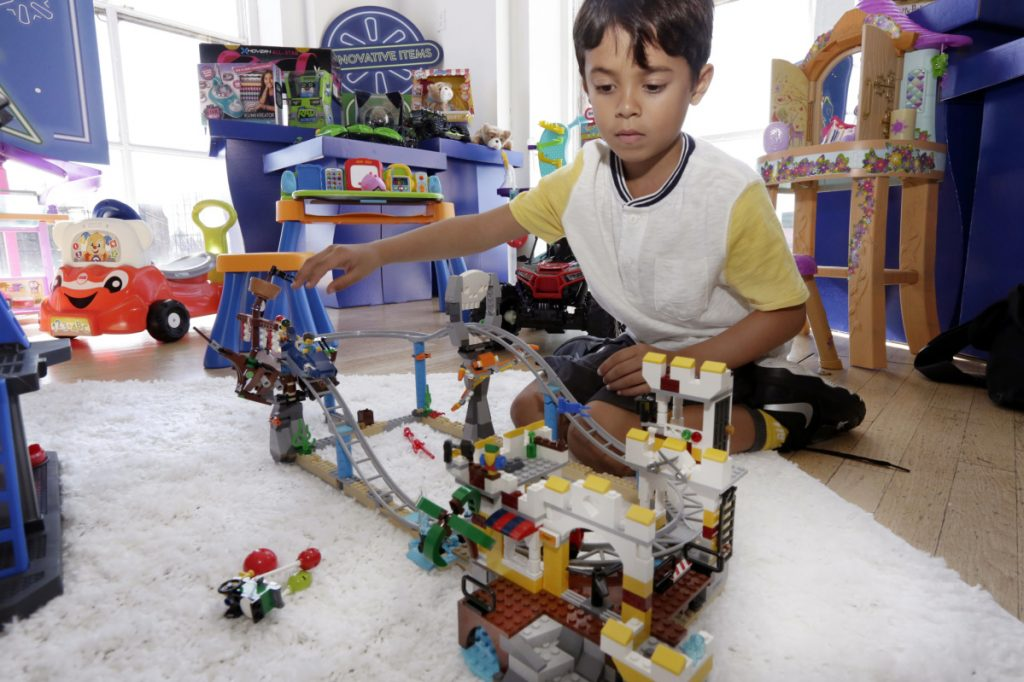 Enzo plays with the Lego Creator Pirate Roller Coaster at a Walmart Toy Shop event in New York. Amazon is competing with Walmart, Target and Kohl's in the $3.3 billion U.S. toy market with a glossy new catalog.