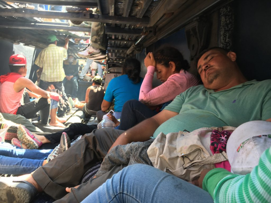 Wilmer, 38, of Guatemala, passes out from exhaustion Monday on the lower deck of a truck ferrying migrants from the city of Cordoba, Mexico, to Puebla, Mexico, part of a parade of people heading toward the United States.