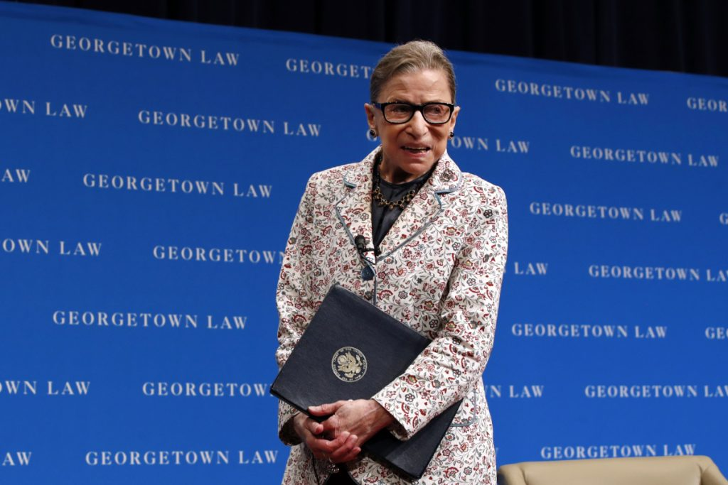 Supreme Court Justice Ruth Bader Ginsburg leaves the stage after speaking to first-year students at Georgetown Law in Washington in  September.
