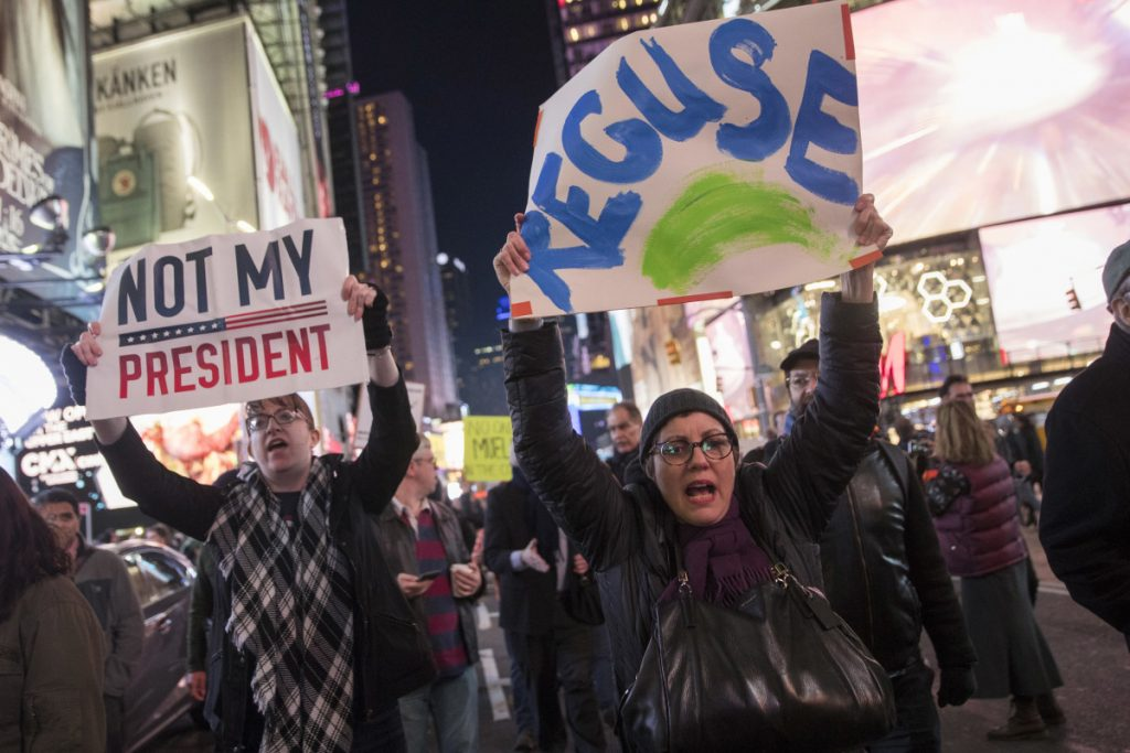 Protesters march through Times Square in New York on Thursday night in a demonstration in support of special counsel Robert Mueller. The protest drew several hundred people calling for the protection of Mueller's investigation into potential coordination between Russia and President Trump's 2016 campaign.