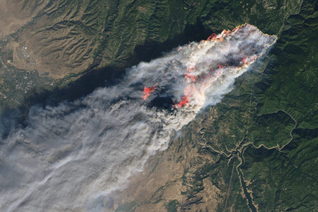 This enhanced satellite image provided by NASA's Earth Observatory, shows a wildfire in Paradise, Calif., on Thursday, Nov. 8, 2018. The fire incinerated most of a town of about 30,000 people with flames that moved so fast there was nothing firefighters could do, authorities said Friday, Nov. 9, 2018. Flames in the image were enhanced with infrared data. (NASA via AP)