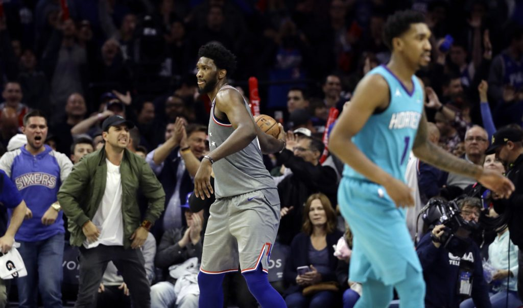 Philadelphia's Joel Embiid, center, celebrates after the 76ers beat the Charlotte Hornets 133-132 in overtime on Friday in Philadelphia. Emiid had 42 points and 18 rebounds.