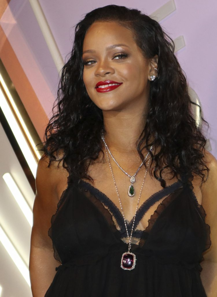 "Rihanna doesn't want her music associated with the president's ""tragic rallies."""