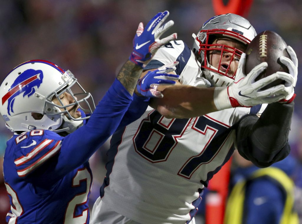 New England Patriots tight end Rob Gronkowski, right, is dealing with back and ankle injuries and is expected to miss Sunday's game at Tennessee.