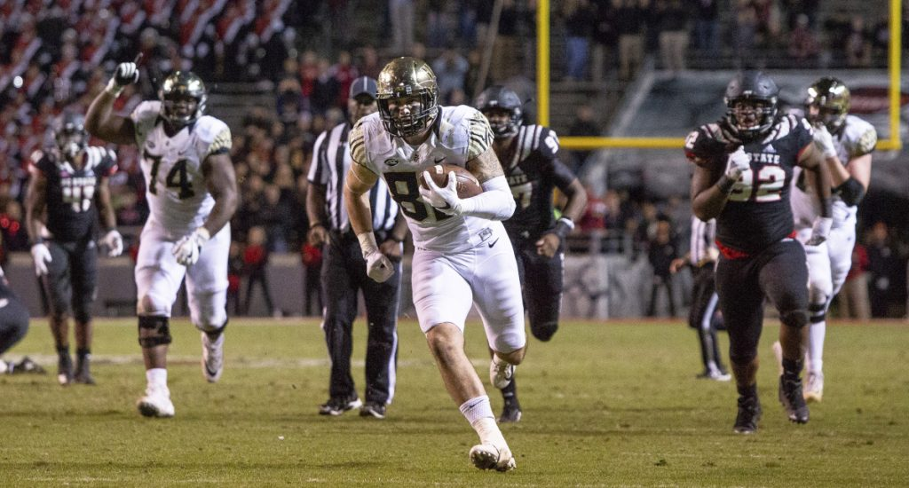 Wake Forest's Jack Freudenthal, middle, breaks free for the game-winning touchdown during the fourth quarter of an NCAA college football game against North Carolina State in Raleigh, N.C., Thursday, Nov. 8, 2018. ()