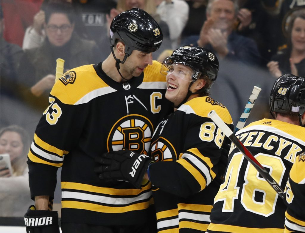 Boston's David Pastrnak, right, is congratulated by Zdeno Chara after scoring against Toronto in the second period of Saturday's game in Boston.