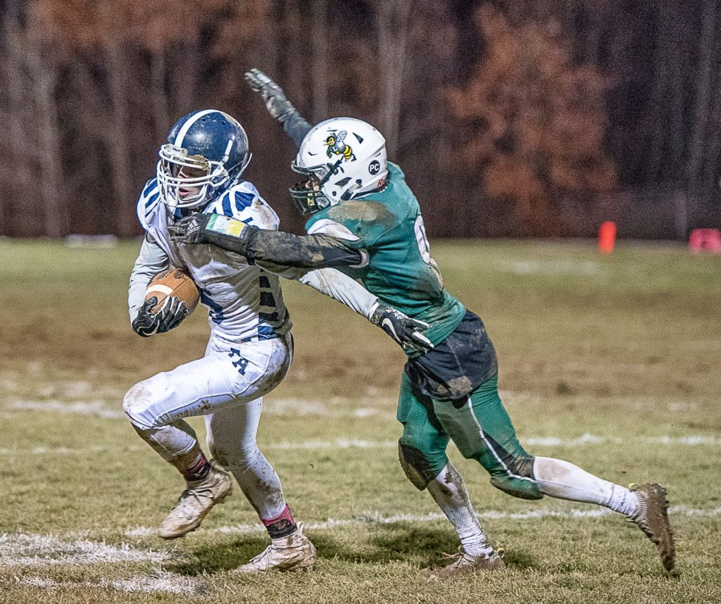 Fryeburg Academy's Dawson Jones is tackled by Damien Calder of Leavitt during the Class C South championship game Saturday night in Turner.