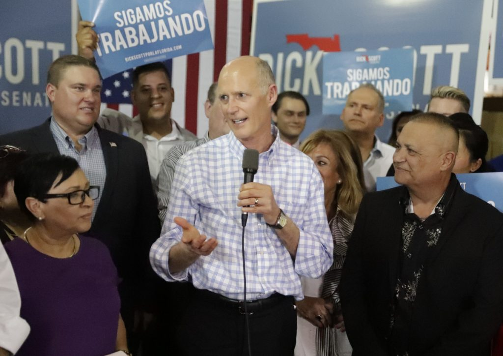 Florida Gov. Rick Scott center speaks at a campaign rally in Orlando on Sept. 18. Associated Press  John Raoux file