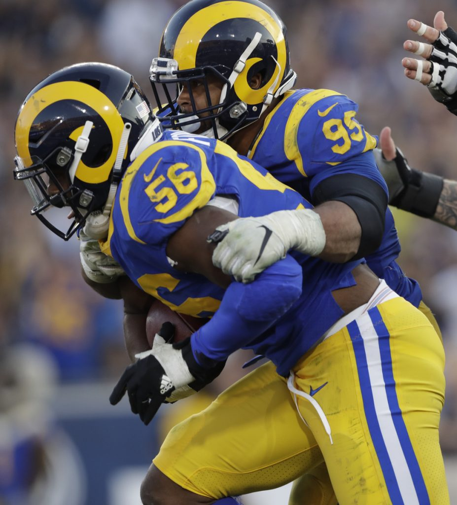 Dante Fowler of the Rams recovers a fumble Sunday against the Seattle Seahawks, helping Los Angeles hold on for a 36-31 win.