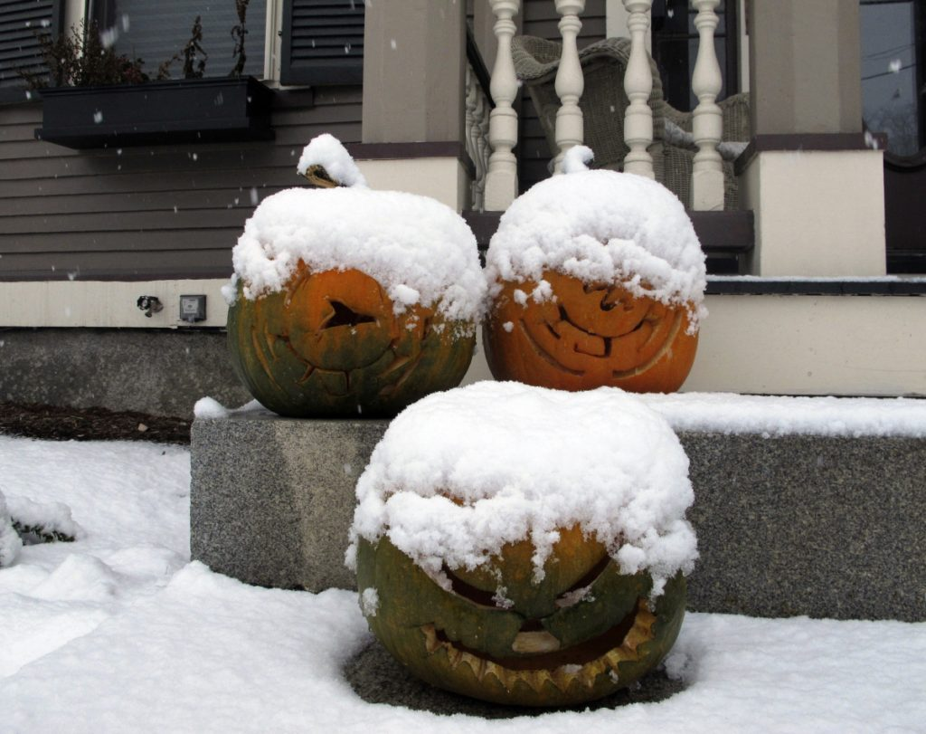 Jack-o'-lanterns are covered in snow Tuesday on the front stoop of a house in Montpelier, Vt. Maine's highest accumulation of 7 inches was in Sangerville, about 45 miles northwest of Bangor.