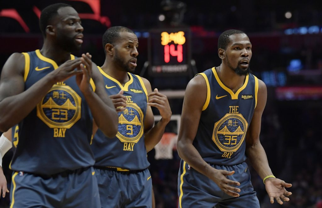 Draymond Green, left, and Kevin Durant, right, got into a heated exchange during Golden State's 121-116 overtime loss to the Clippers in Los Angeles on Monday, leading the Warriors to suspend Green for Tuesday's game against Atlanta.
