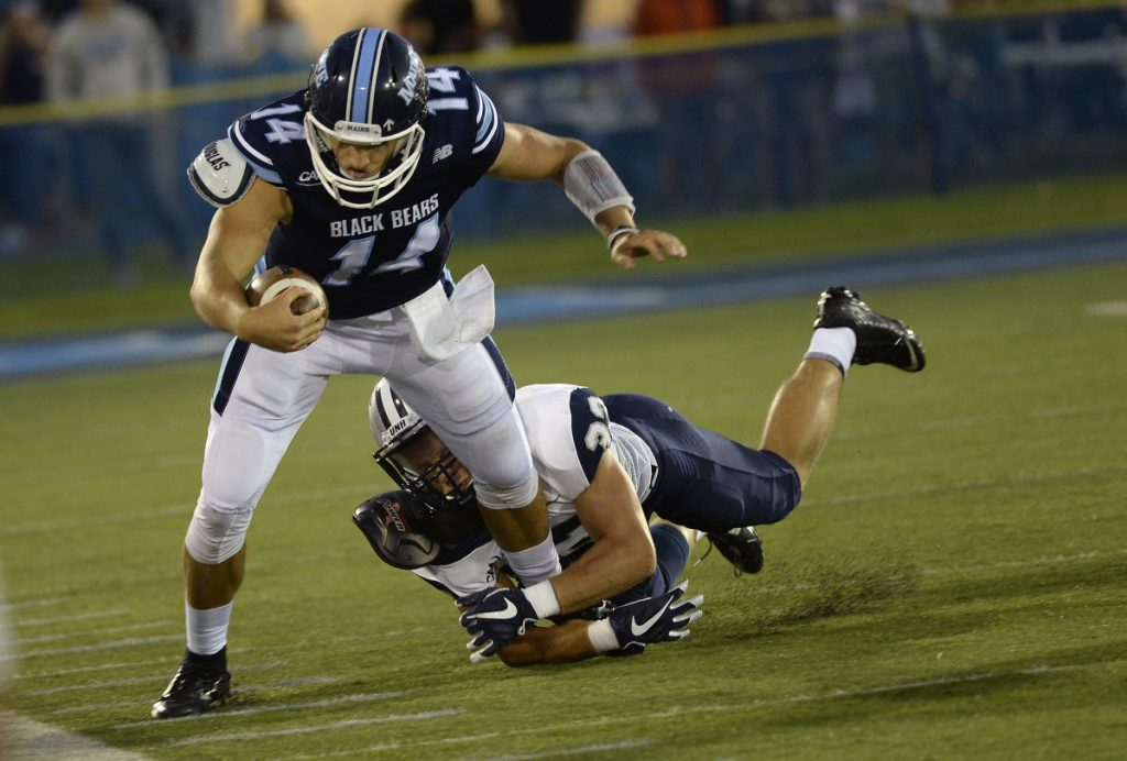 """UMaine's Chris Ferguson, shown rushing for a first down against New Hampshire in the season opener, says his latest injury is """"not as serious"""" as the one that caused him to miss nearly three full games earlier this fall. (Staff photo by Shawn Patrick Ouellette/Staff Photographer)"""