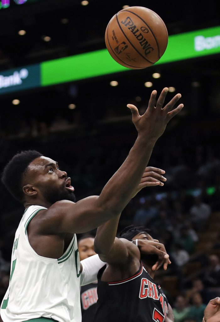 Jaylen Brown drives to the basket against Justin Holiday of the Bulls during Boston's 111-82 win Wednesday night at TD Garden. Brown led a balanced offense with 18 points.