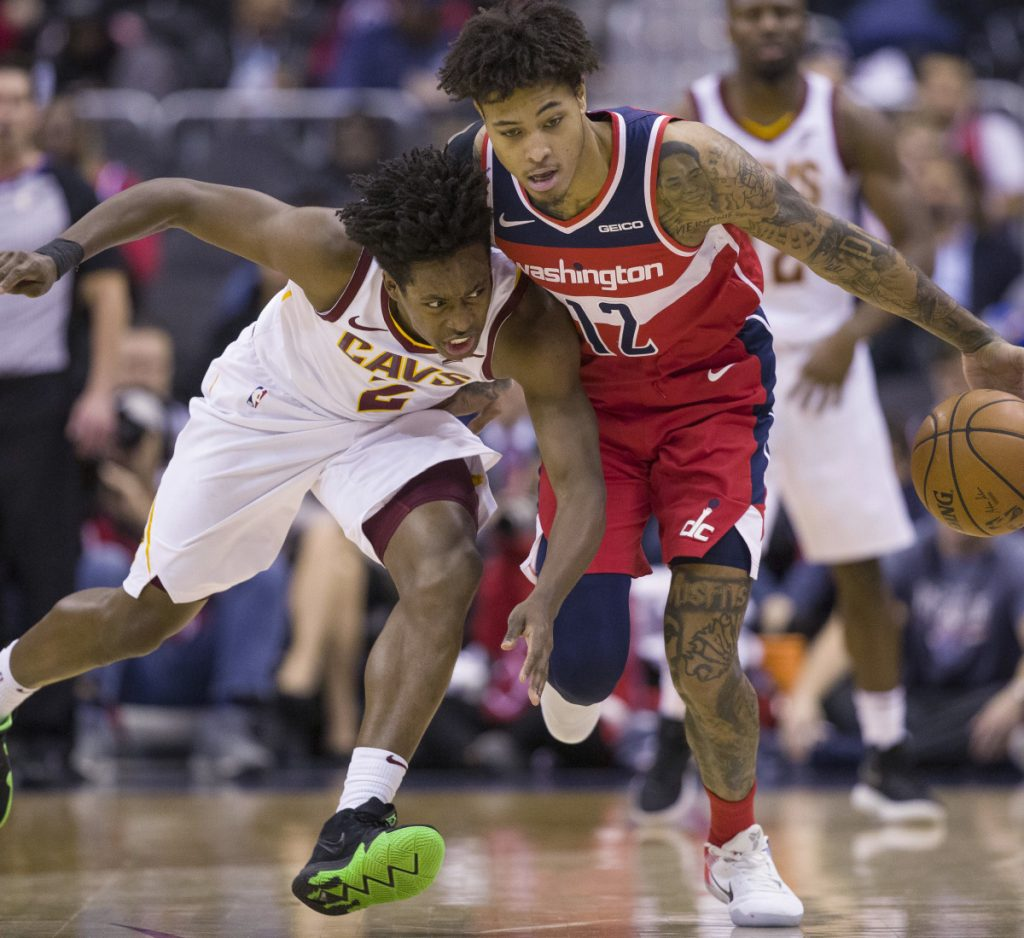 Wizards forward Kelly Oubre Jr., right, steals the ball from Cavaliers guard Collin Sexton during the second half of their game in Washington on Wednesday night. The Wizards won, 119-95.