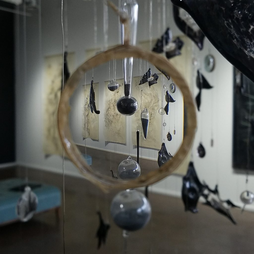 """Detail from the glass installation """"Flight and Fall."""""""