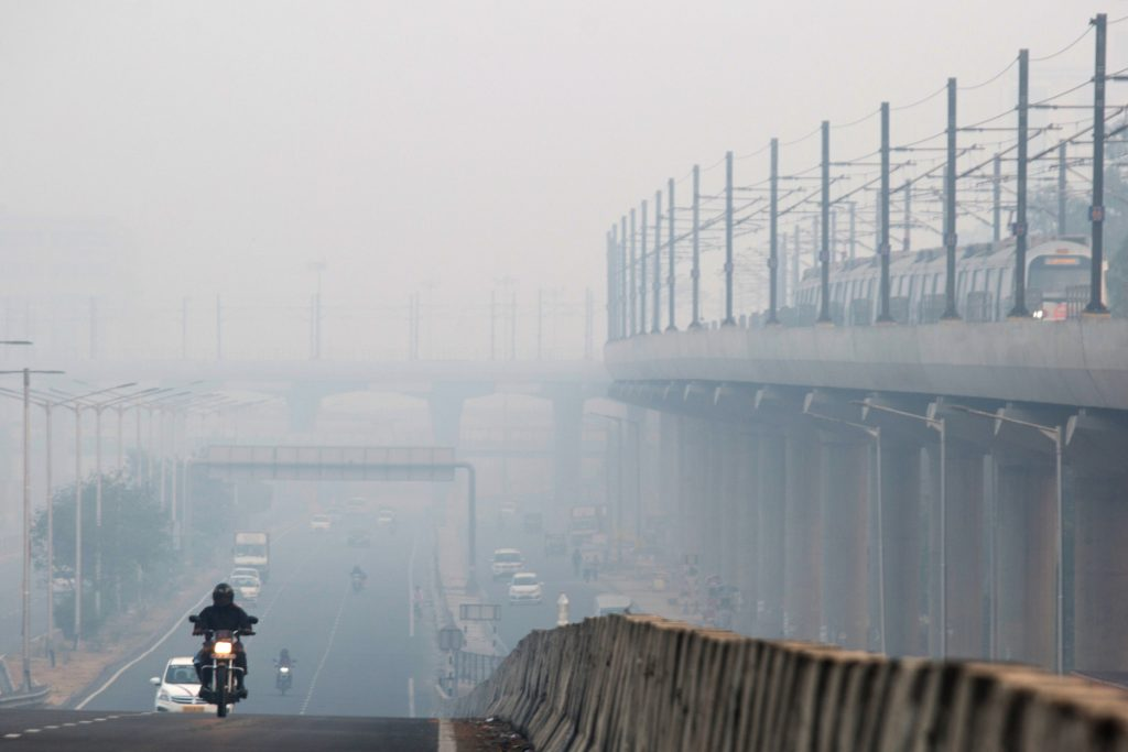 Drivers are shrouded in smog in Delhi, India, on Nov. 9. According to the World Health Organization, the city has the most polluted air of any major metropolis.