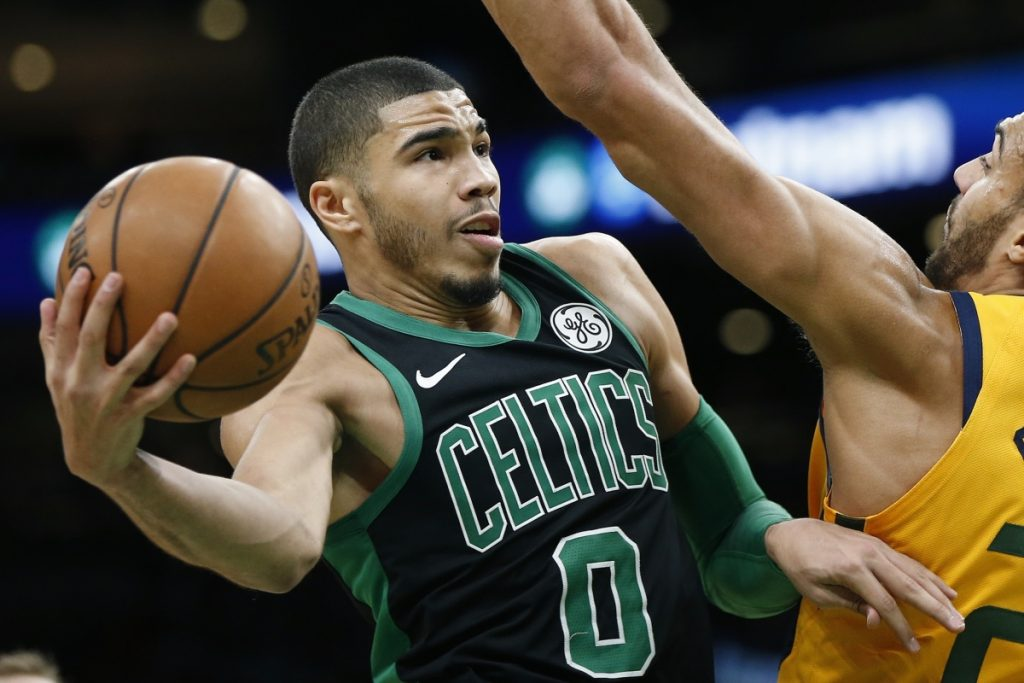 Boston's Jayson Tatum shoots against Utah's Rudy Gobert during Saturday's game in Boston.