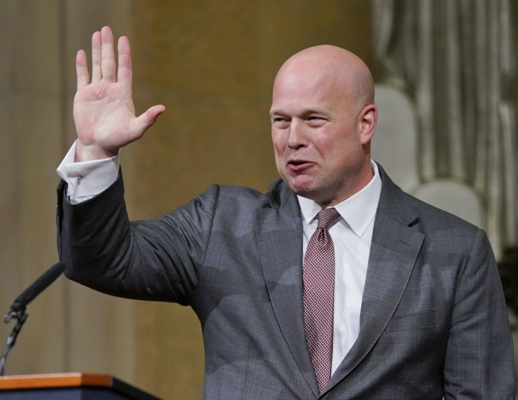 Acting Attorney General Matthew Whitaker gestures after speaking at the Deptartment of Justice on Thursday in Washington.