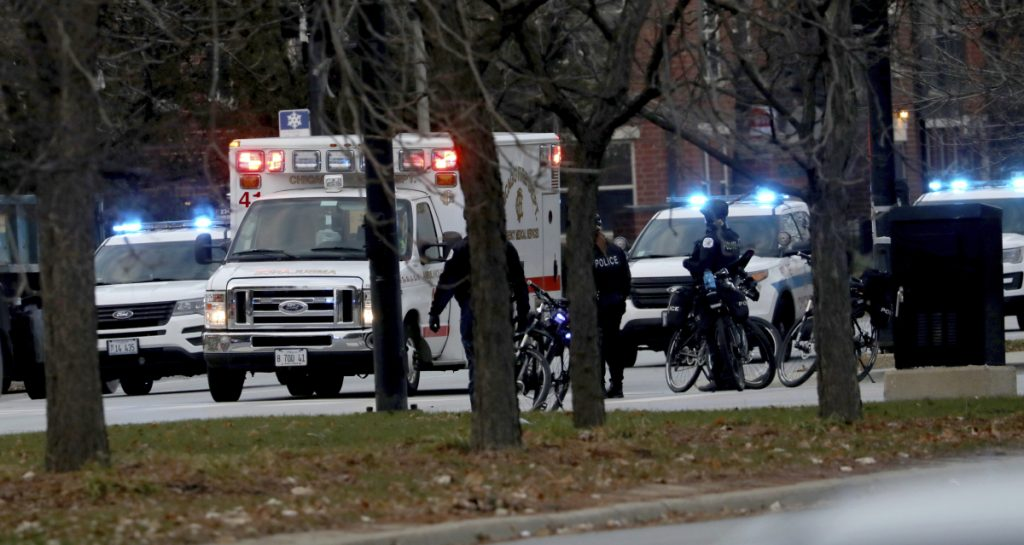 An ambulance believed to be carrying an injured Chicago police officer departs Mercy Hospital on Monday in Chicago.