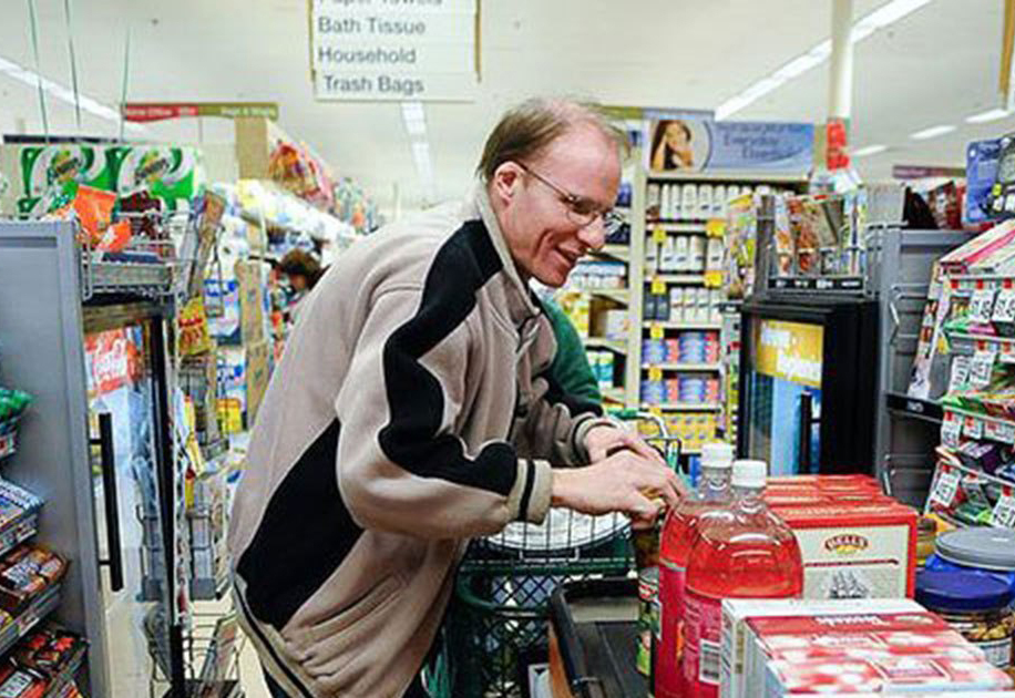 Scott Macaulay shops for groceries in preparation for a previous Thanksgiving feast in Melrose, Mass.