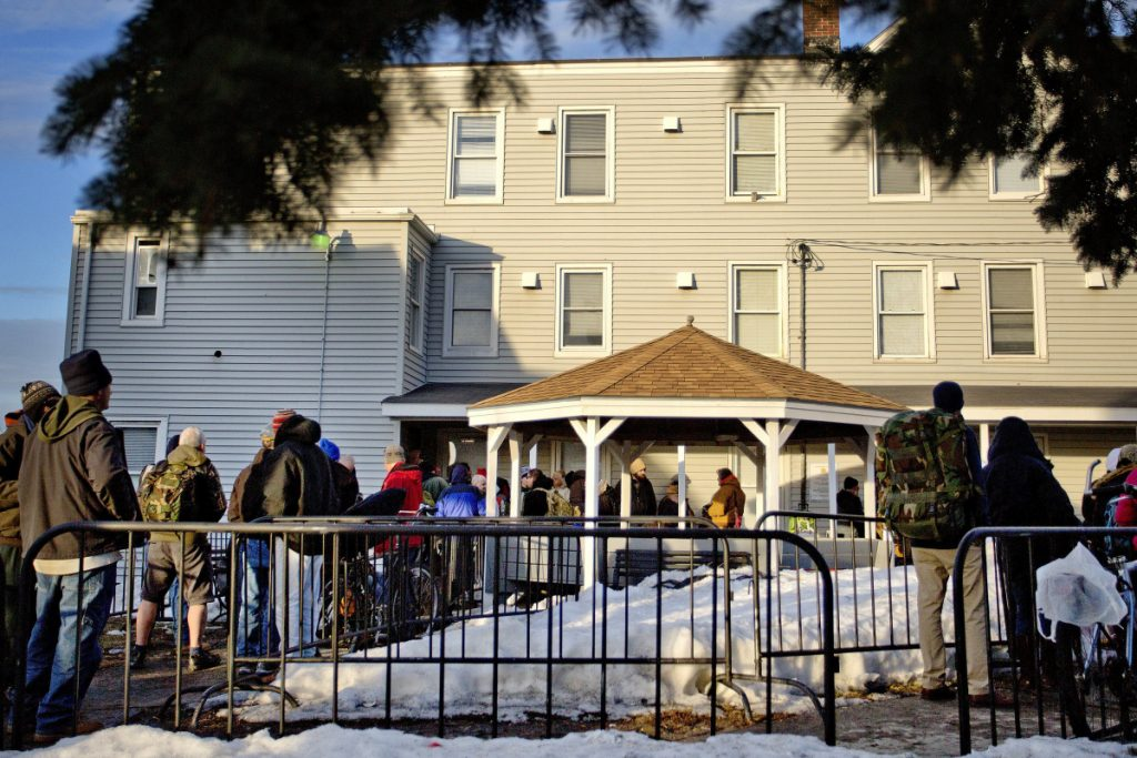 People wait in line in 2015 to enter the Oxford Street Shelter in Portland. The outdated and overcrowded facility has operated in Bayside for over 30 years.