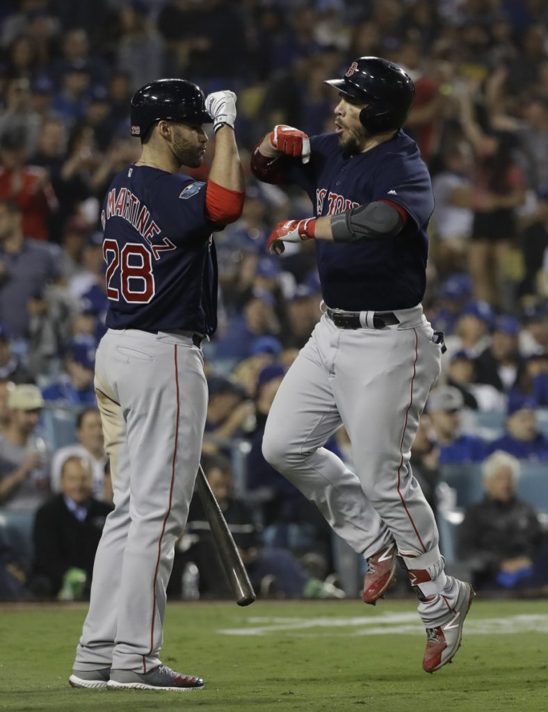 Boston's Steve Pearce celebrates his second home run of Game 5 of the World Series with J.D. Martinez. Pearce will return to the Red Sox after signing a one-year, $6.5-million contract.