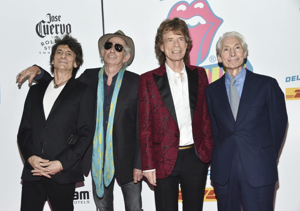 "FILE - In this Nov. 15, 2016 file photo, The Rolling Stones, from left, Ronnie Wood, Keith Richards, Mick Jagger and Charlie Watts attend the opening night party for ""Exhibitionism"" in New York. The Rolling Stones will be rolling through the U.S. next year. The band says it is adding a 13-show leg to its No Filter tour in spring 2019, kicking off in Miami on April 20. (Photo by Evan Agostini/Invision/AP)"