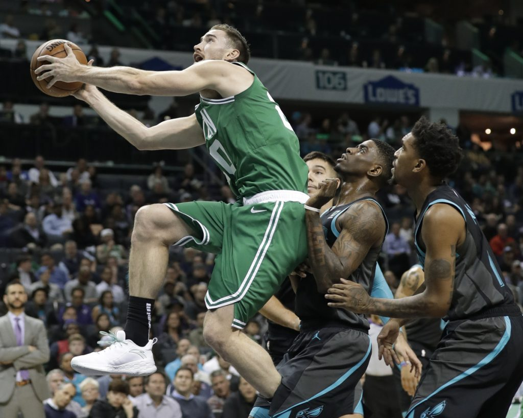 Boston's Gordon Hayward, left, drives past Charlotte's Malik Monk, right, and Dwayne Bacon during the Celtics' 117-112 loss Monday in Charlotte, North Carolina.